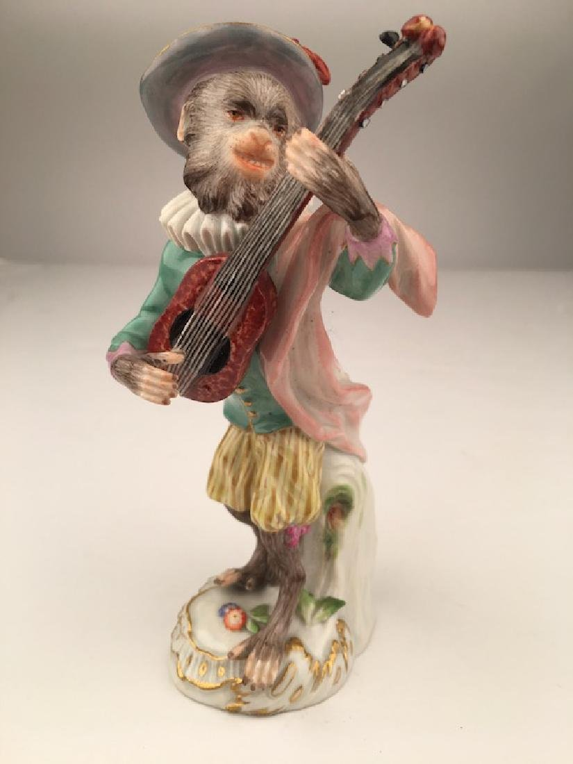 Meissen porcelain monkey  band member playing a guitar.