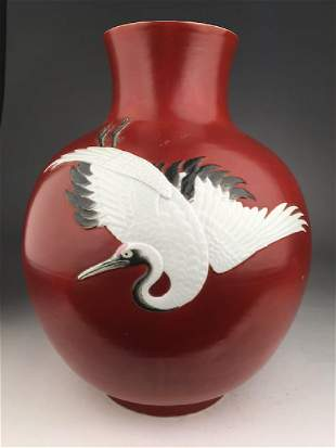 Circa 1900 Japanese Moriage porcelain vase with an