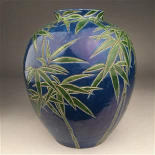 Circa 1900 Japanese studio porcelain vase with bamboo