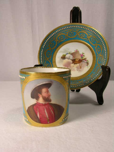 4088: SEVRES CUP AND SAUCER.THE SAUCER IS PAINTED WITH
