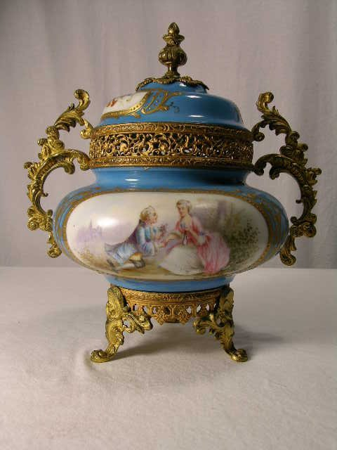 4089: SEVRES TWO HANDLE COVERED URN.THE TWO CARTOUCHES