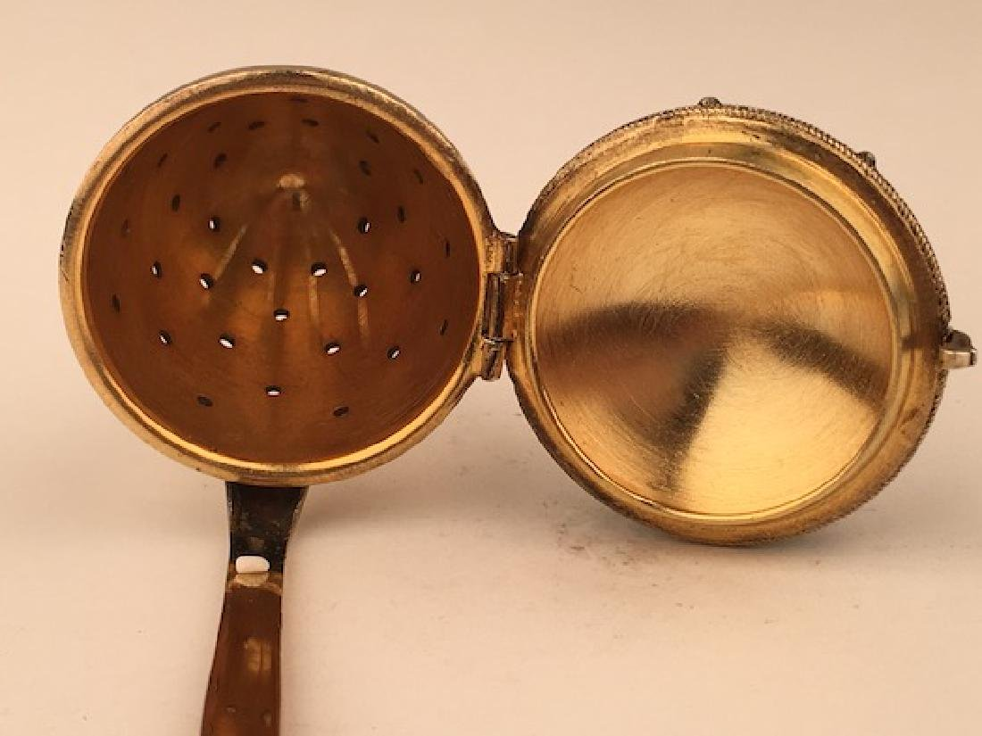 Silver gilt and enamel tea strainer. - 4