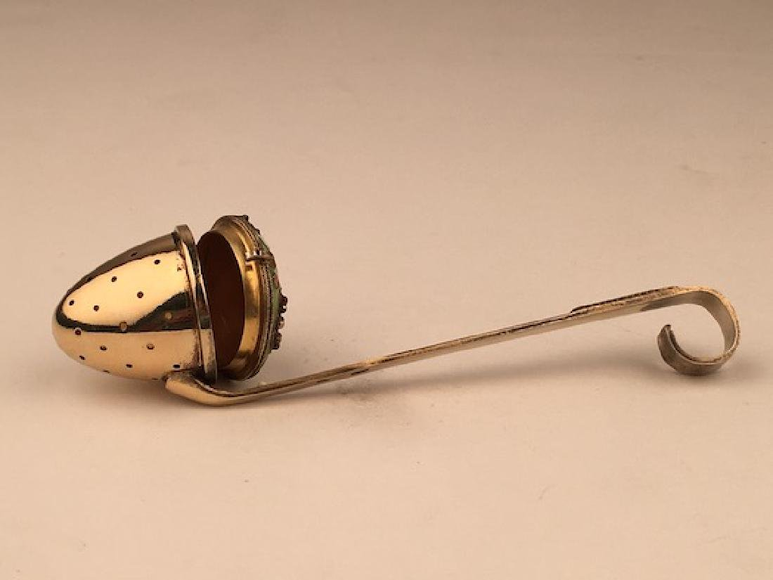 Silver gilt and enamel tea strainer. - 5