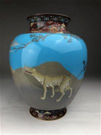 A rare and unusual Japanese cloisonne vase with a wild