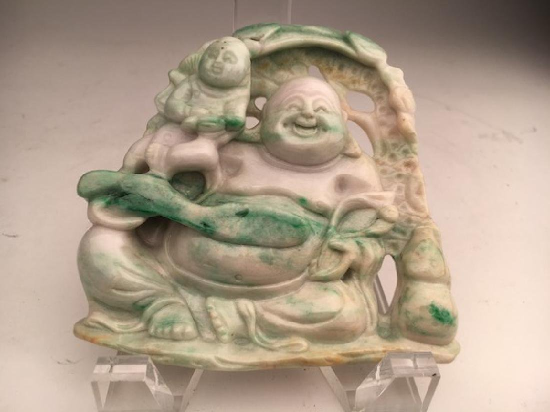 Carved Chinese jade figure of a smiling Buddha.