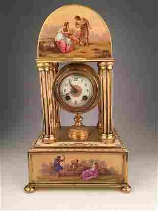 Royal Vienna porcelain clock supported on four bunn