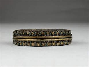 Cloisonne round box with the top decorated with a bird