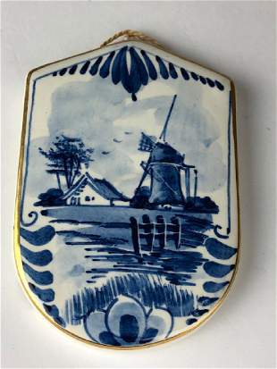 Delft blue and white porcelain plaque in the shap of a
