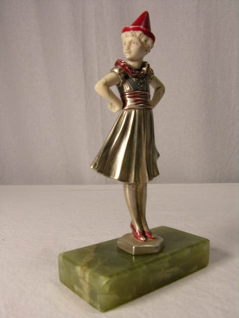 """513: IVORY AND PATINATED BRONZE FIGURE """"PIERRETTE""""."""