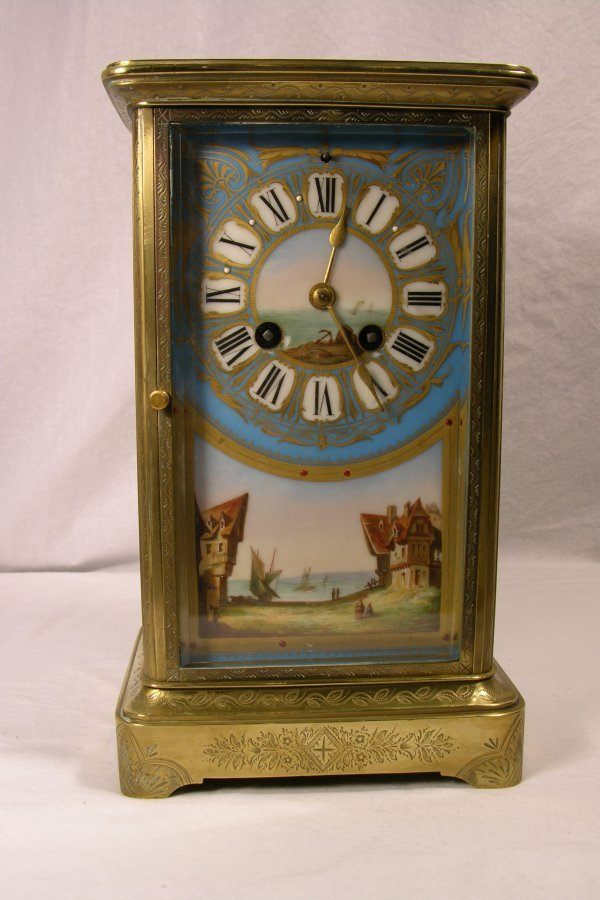 640: FRENCH MANTEL CLOCK BRASS WITH CHASED CASE AND T