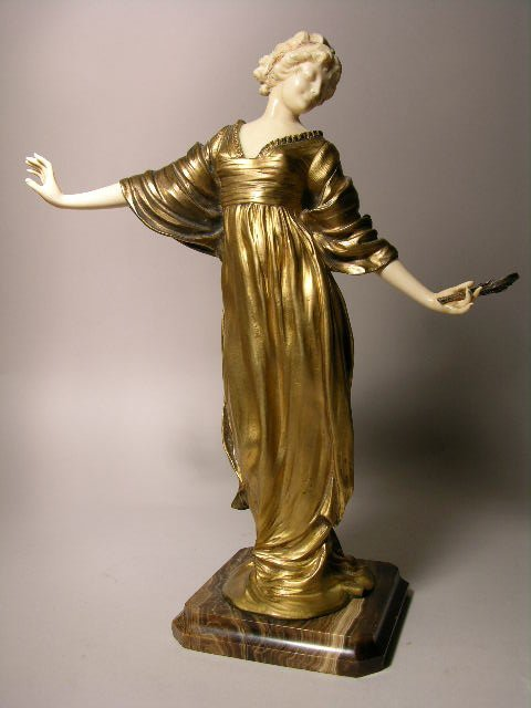 519A: BRONZE AND IVORY FIGURE:P. PHILLIPPE.