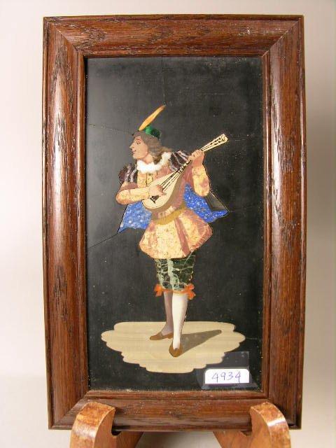 703: PIETRA DURA PLAQUE OF A MAN PLAYING THE MANDOLINE.