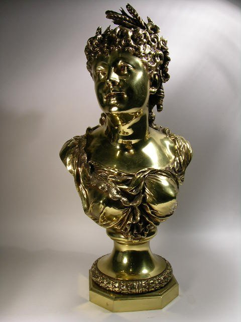 715: BRONZE BUST OF A GRECIAN APPEARING WOMAN.  SIGNED