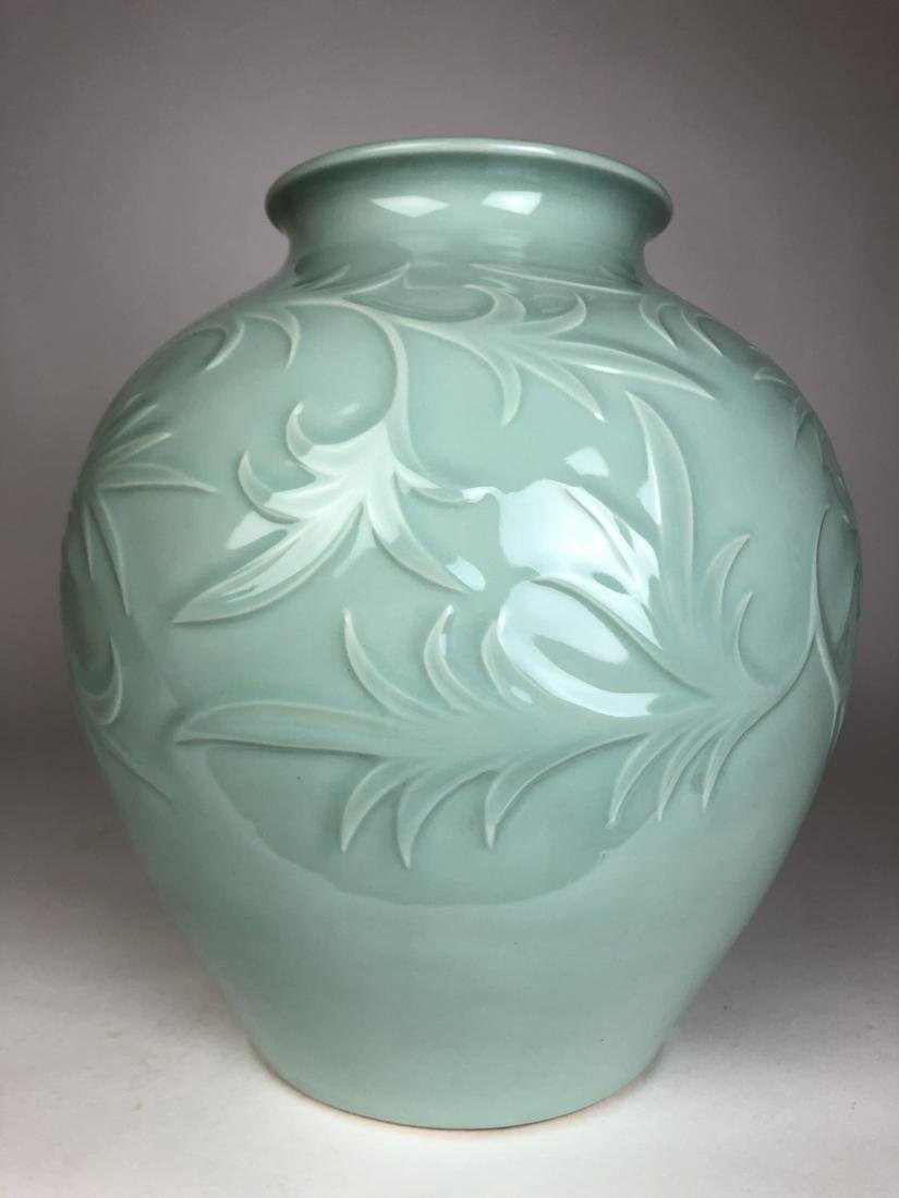A very large porcelain baluster vase highly chased deco