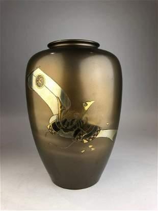 A Japanese bronze and mixed metal vase depicting a Samu