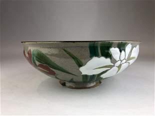 Japanese stoneware footed bowl with raised iris flowers