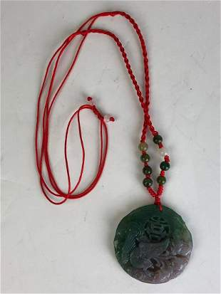 Japanese jade pendant with carved birds