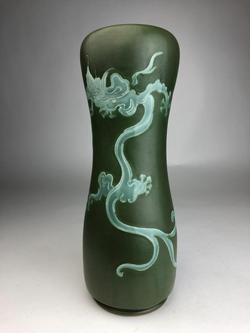 A rare porcelain shaped vase with a raised dragon in se