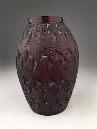 "R. Lalique ""Grignon"" vase in a amber color glass."