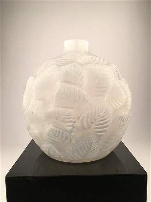 """Rene Lalique """"0rmeaux"""" vase in a milky white glass with"""