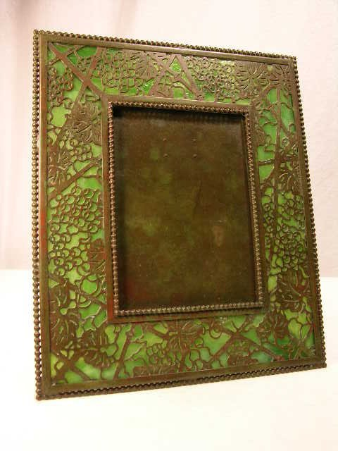 "1028: TIFFANY STUDIOS PHOTO FRAME IN THE ""GRAPE VINE"" P"