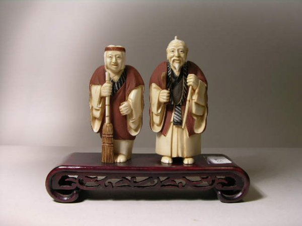 1126: PAIR CHINESE CARVED  SWEEPER FIQURES.