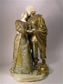 1219: MARQUET BRONZE AND IVORY FIGURINE.