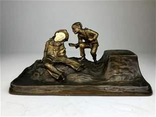 Austrian bronze figural Inkwell pen rest front