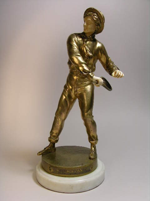 1364: S. KINSBURGER;BRONZE CARVING OF A TENNIS PLAYER.