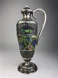 A fine Japanese silver and enamel ewer enhanced with