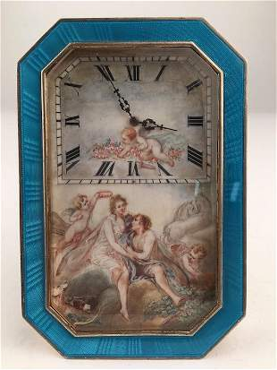 Enameled silver clock decorated with young winged