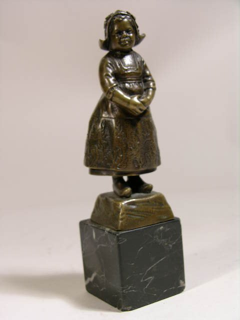 2301: BRONZE FIGURE OF A YOUNG DUTCH GIRL.