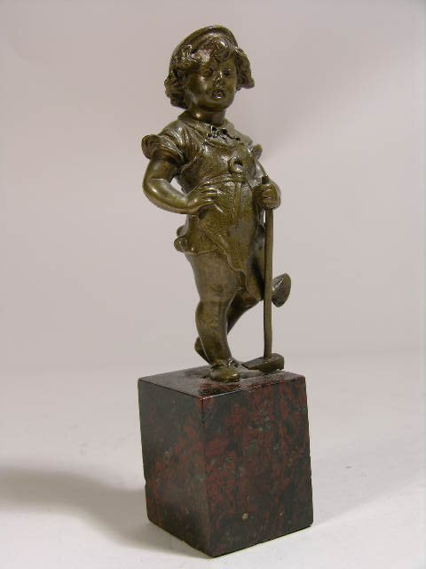 2302: BRONZE FIGURE OF A YOUNG  GIRL WITH HAMMER.