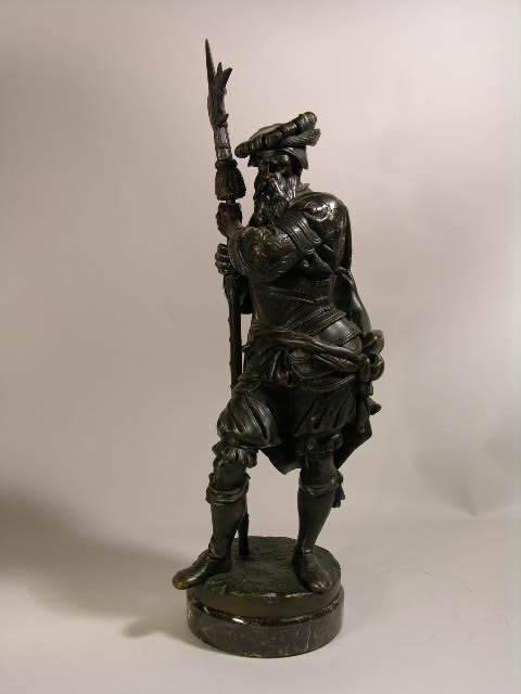 2303: A. CARRIER BRONZE FIGURE OF A MAN WITH WEAPON.