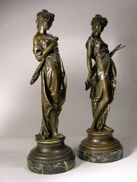 2304: A PAIR OF BRONZES, ONE OF A FEMALE HOLDING A ROSE
