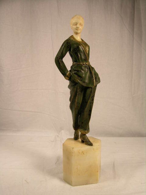2306: GORI BRONZE AND IVORY FIGURE.   ART DECO COLD PAT