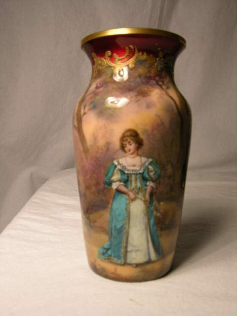 2508: SMALL HAND ENAMELED VASE.   A WOMAN AMID A FOREST