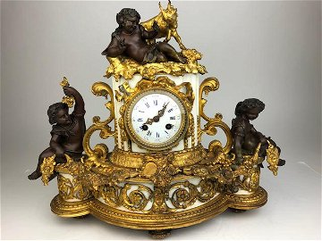 Antique French bronze and gold gilt marble mantle