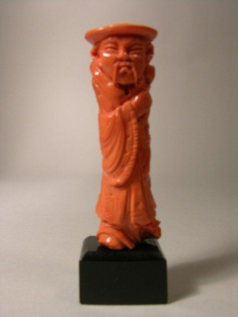 """2763: CORAL CARVING OF A MAN. 3 1/4""""."""
