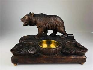 Antique Swiss black forest wood Bear with glass eyes