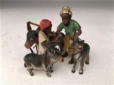 Franz Xavier Bergman, 1861-1936. Two men and donkeys.