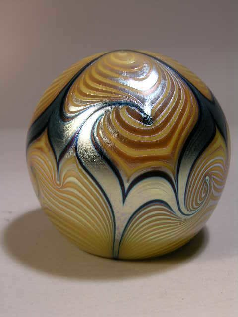 1007: CORREIA IRIDESCENT GLASS PAPERWEIGHT.