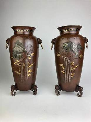 A fantastic and rare pair of mixed metal vases with