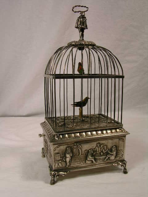 21: STERLING SILVER MECHANICAL SINGING BIRD  BOX.