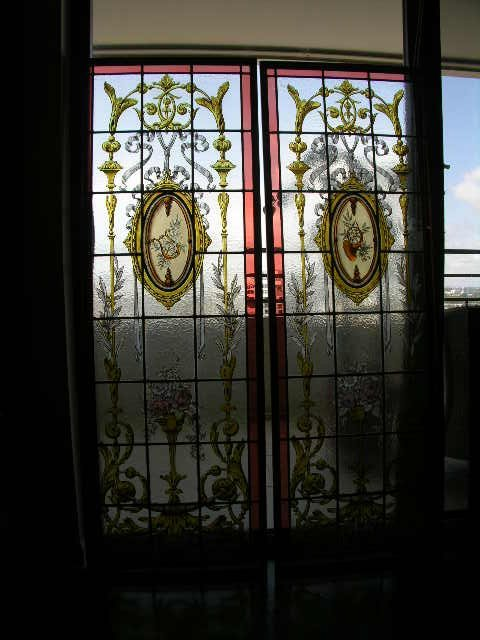 501: PAIR OF ANTIQUE STAINED GLASS PANELS.
