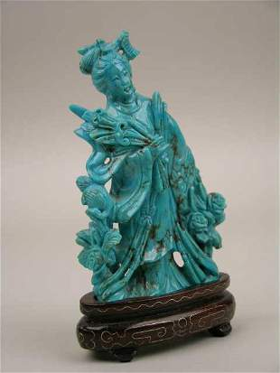 CARVED TURQUOISE FIGURE OF A MAIDEN WITH A SWORD.