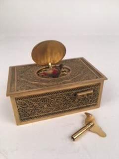 A bronze mechanical singing bird box.