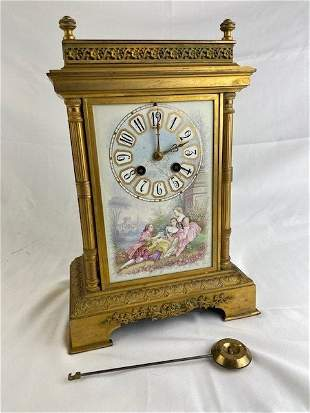 French mantle clock with a painted porcelain plaque