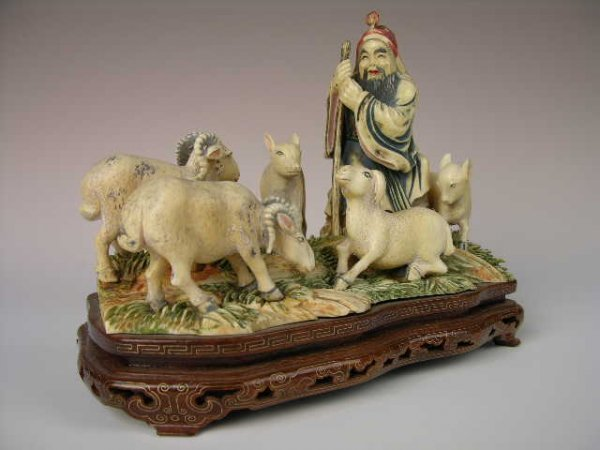 175: IVORY AND POLYCROMED CARVING OF A SHEPARD WITH 5 A