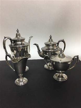 Four piece sterling silver tea set,